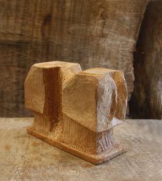 塊が細分化されさらに強い方向を持たせるため粗い面を出す。