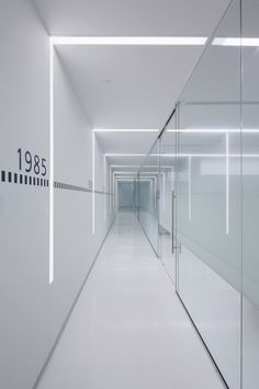 Image 1 of 28 from gallery of AGP eGlass Factory & Offices / V. Photograph by Juan Solano Office Space Design, Dental Office Design, Office Interior Design, Office Interiors, Boutique Bio, Corridor Lighting, Corridor Design, Clinic Design, Architecture Office