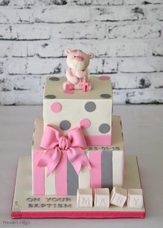Teddy Bear Baptism/Christening Cake with vertical stripes, polka dots, and Baby blocks.  Handmade fondant bow, with hand crafted fondant teddy bear cake topper.