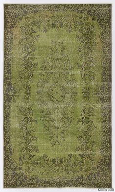 "For a contemporary look with abstract appeal, this green over-dyed rug is skillfully crafted by the revitalization of a hand knotted vintage Turkish rug. Made from wool on cotton, this ""distressed"" rug measures 171 cm x 295 cm. The process in creating these works of art begins by shearing to lower the pile and to help ""distress"" them. They then undergo a series of processes to remove the color. They are now ready to be dyed in one color, a stage that can be repeated several times to reach t…"