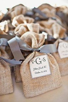 Guest goodie bags in burlap sacks fall-wedding  (add: custom chocolates. ONLY $7  www.customweddingprintables.com)