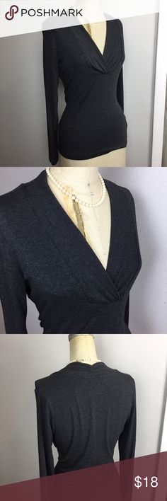 Banana Republic - V neck top Just like a t-shirt, but classy :) Deep V, heathered grey, hip length, stretchy. Would go great with your favorite scarf!  Banana Republic Tops Tees - Long Sleeve