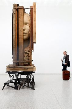 Venice biennale: A visitor looks at the installation Working Table by Mark Manders in the Du