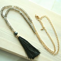 Beaded sophisticated tassel necklace. Lobster claw closure. Perfect for work or fun. 50% of all net proceeds donated to animal rescue charities.