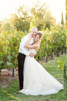 The bride and groom in the vines after their vineyard wedding at Mount Palomar Winery in Temecula. The bride wore a beautiful A-line dress with lace appliques and had a beautiful up do. #mountpalomarwineryweddings