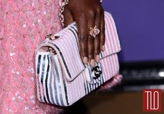 Lupita Nyong'o attends the 2014 BAFTA Awards Nominees Party in London in a Chanel Fall 2012 Couture Collection dress paired with Christian Louboutin pumps, Cartier jewelry, and a Chanel bag. Posted on February 18th, 2014, at TomAndLorenzo.Com. (View #3 of 4)