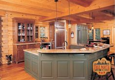 """What can you say about this True North Log Home kitchen? Three words come to mind when I look at it - """"Built For Entertaining""""! The wrap around island provides plenty of room for guests to sit at while enjoying their appetizers, sipping on a drink of choice all the while watching the """"chef"""" prepare an awesome entree! Please """"Like"""" or """"Share"""" this image if can picture yourself serving up some awesome apps to your guests here! (PS...Check out the beautiful interior dove-tail corners on the…"""