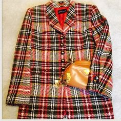Rena Lange Plaid Blazer Rich blazer in rust, black, green & a hint of yellow. Form fitting accentuates that hour glass look. This blazer is long therefore it looks great with skinnies & an awesome pair of heels. The buttons are a braided leather with a gold embossed duck. Should you have questions please ask. Thank you Rena Lange Jackets & Coats Blazers