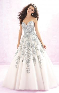 Madison James Bridal MJ119 is a ballgown dress for the princess. This strapless ballgown with a sweetheart neckline is adorned with a flower design that fades down the skirt. With the option of the blue flowers, you can have