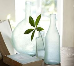 Sea Glass Vases #potterybarn -- these would be so easy to make with bottles bought at yard sales and a can of frosted glass spray paint!!!