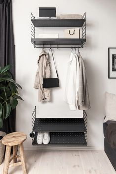 Minimal open wardrobe storage made from String shelving - Informations About Minimal open wardrobe storage made from String shelving Pin You can easily use - Open Wardrobe, Wardrobe Storage, Hallway Storage, Bedroom Storage, String Shelf, Student Room, Small Hallways, Cupboard Design, Hanging Rail