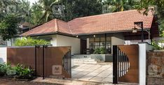 Though this house looks like single storied from the outside, it actually is double storied. Village House Design, Kerala House Design, Bungalow House Design, Village Houses, Modern House Design, Duplex House, Kerala Traditional House, Traditional House Plans, Modern Traditional