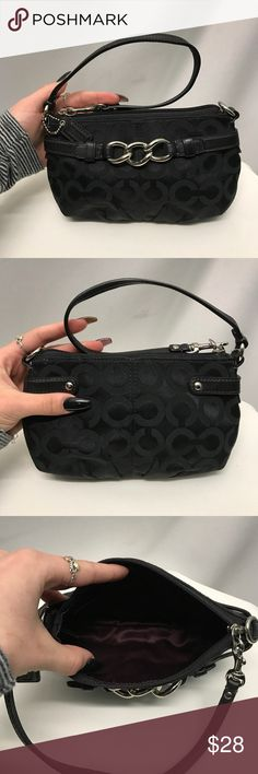 """COACH small handbag Black cloth with the classic """"C"""" logo print and silver hardware. Beautiful maroon interior with one small pockets. Includes authentication card. Coach Bags Mini Bags"""