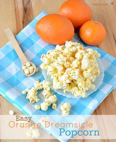 Easy Orange Dreamsicle Popcorn on { } Dessert Dessert Best Popcorn, Popcorn Snacks, Flavored Popcorn, Gourmet Popcorn, Popcorn Recipes, Snack Recipes, Popcorn Balls, Popcorn Shop, Homemade Popcorn