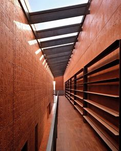 Italy's Curno public library and auditorium by Archea Associati stands as a monolith of concrete pigmented with iron oxides. While a complex for community services, the structure posits itself as a space for meditation and introspection. : Pietro Savorelli. #architecture #interior #design #interiordesign #italy #library #publicspace... - Interior Design Ideas, Interior Decor and Designs, Home Design Inspiration, Room Design Ideas, Interior Decorating, Furniture And Accessories