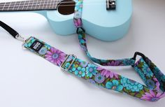The Hug Strap is unique because it is made from three separate pieces, allowing adjustment at both the headstock and and at the belt portion which means it can fit any size ukulele from the Soprano size through the Baritone and it can be adjusted to be placed anywhere on the body (up high