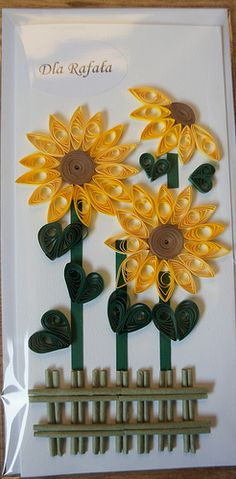 handmade card ... tall and thin ... trio of quilled sunflowers ... die cut picket fence ... makes me want to smile ...