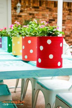 This DIY Tin Can Flower Garden is colorful, fun, and budget-friendly! The perfect DIY project. A Colorful and Fun Tin Can Flower Garden Makes the Perfect Backyard Fence Decor Budget Patio, Diy Patio, Outdoor Patio Ideas On A Budget Diy, Backyard Ideas, Garden Diy On A Budget, Wood Patio, Tin Can Flowers, Diy Flowers, Patio Decorating Ideas On A Budget