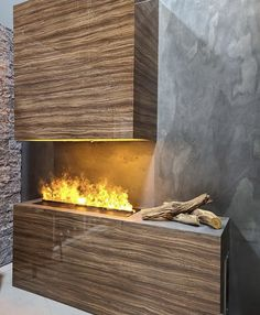 What's open on 3 sides, features clean lines, and an inspiration for your next home reno? It's this stunning Opti-myst installation of course!🔥 This beautiful display of creativity features the Dimplex Opti-myst cassette (CDFI1000-PRO) that has been built into a marvelous statement piece. Fireplace Accessories, Next At Home, Home Renovation, Electric Fireplaces, Clean Lines, Building, Outdoor Decor, Projects, Creativity
