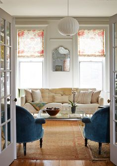 French doors open into a bright living room