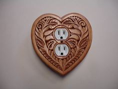 Heart shaped uniquely designed electric outlet by creativemind44