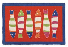 These adorable striped fish form a picket fence dancing across an orange background wool hooked rug with a dark blue border. Super fun!