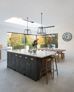 Plenty of storage in this large kitchen island featuring both cupboards and drawers.