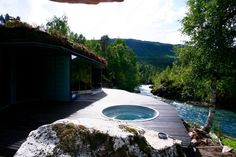 hot tub integrated into the decking...we could have a wooden cover for it so that when it is covered it blends perfectly into the deck.....juvet landscape hotel norway