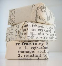 Wrap with old dictionary pages. This would be super cute as wrapping for blocks of homemade soap.