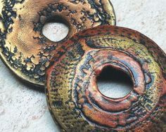 Polymer clay domed donut beads. Natural patterns both sides in shades of rusty red and metallic bronze