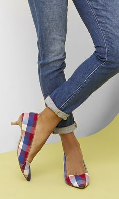 Blue & red checkered kitten heel pump with a pointed toe and stacked heel