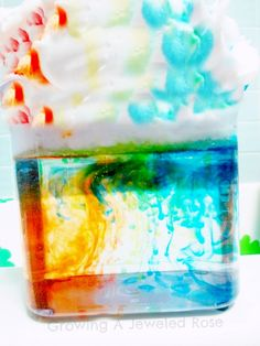 A clear container,shaving cream,food coloring,water  Fill the container 3/4 with water.  Then cover the top with shaving cream to create cloud peaks.  Have your child drop food coloring on top of the cloud in rainbow order.  Then have them syringe water over top of the food coloring drops to make it RAIN!