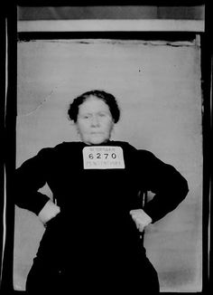 """Jennie Lester was not much impressed with the officers who took her mug shot. Lester was arrested in Phelps County, Nebraska for """"enticing to illicit intercourse,"""" and sentenced to 1-3 years in the Nebraska State Prison."""