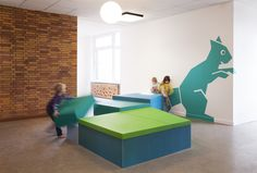 Sinnewandel Kindergarten in Berlin designed by Baukind and Atelier Perela. Giant animals induce play. Matted platforms for performances or physical play.