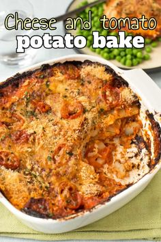 Cheese and tomato potato bake - this crispy gratin is super easy to make! It's layered up with mature cheddar cheese, thinly sliced potatoes, and a rich tomato sauce - the perfect side dish. #potatobake #potatogratin Vegetarian Appetizers, Vegetarian Lunch, Vegetarian Dinners, Vegetarian Recipes, Cheesy Potatoes, Sliced Potatoes, Bean Recipes, Veggie Recipes, Humble Potato