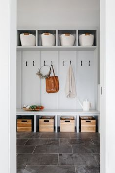 mudroom space with cubbies for baskets, a bench seat, and black hooks. Cabinet Paint Colors, Door Paint Colors, Farmhouse Design, Modern Farmhouse, Farmhouse Style, Rustic Staircase, Luxury Vinyl Plank, Kitchen Cabinetry, Custom Cabinets