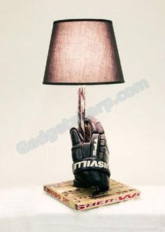 Hockey glove lamp with a stick base.