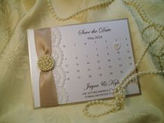 Pearl and lace save the date card.