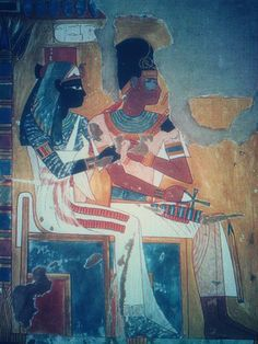 Pinner says: Amenhotep I and Queen Ahmose Nefertari -(I´m not sure at all, must check this picture out, look as a goodess. but I do love the colours of the mural!)