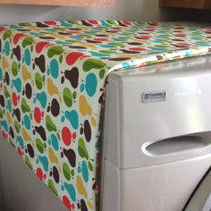 Magnetic ironing board mat. One yard bottom pattern cotton fabric, one yard top pattern cotton fabric, one yard Insul-Bright batting, eight round magnets. Cut to fit over dryer top and magnetize down sides. Sew inside out and... Voila!  @bobbiejeannbannerman