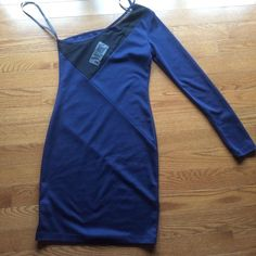 Party Dress Cute blue with black sheer one sleeve party dress. Purchased from Macy's never worn, still has tags. Bought is juniors dresses. Dresses Mini