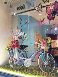 Artist, Juliet Hone, has brought us another beautiful window display! This time Julie created an explosion of color to contrast our previous all-white window. Her inspiration came when she saw a ma...