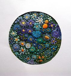 I like the variety of stitches in this, and the imaginative choice of colors.