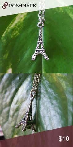 Eiffel Tower Necklace Beautiful Eiffel Tower Necklace. Three dimensional. Chain is silver plated finished with a lobster claw clasp. Measurements of the tower are 1 inches tall by 3/8 an inch wide. Chain length is 18 inches. Jewelry Necklaces
