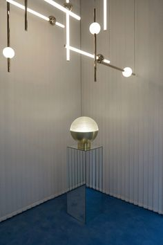 The design is influenced by telescopic lenses. It combines a solid base with an acrylic dome, which is cut with crisscrossing lines to diffuse and refract the light from the LED inside.
