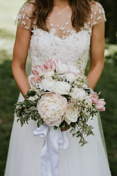 pretty pale pink and white bouquet / photo by Aster & Olive / Real Wedding: Amy & Gregory's Modern Whimsical Cleveland Wedding
