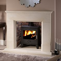 Parrona Large Honed Material: Umbrian Limestone Overall Height: Overal Width: / Shelf Depth: / Description: Umbrian stone fireplace shown with large rainbow brick chamber, Umbrian stone hearths & Sirius . Hearth Stone, Brick Hearth, Stone Fireplace Surround, Natural Stone Fireplaces, Fire Surround, Rock Fireplaces, Log Burner Living Room, Living Room With Fireplace, Stone Veneer Panels