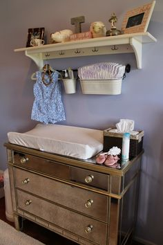 Using a dresser as a changing table. Get Billy to mount the shelf so it doesn't destroy worlds. Skip the hanging dress.