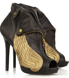 Alexander McQueen winged ankle boots.