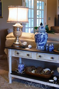 Sofa Table redone from Stone Gable. Love the mix of blue, seashell, and silver.